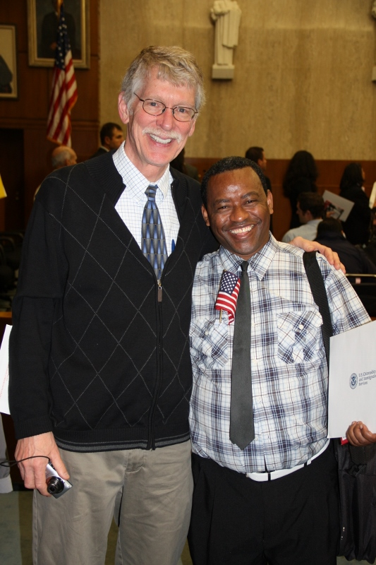 Kevin with Joseph's House resident on the day he became a US citizen